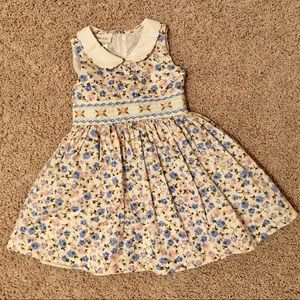 Floral smocked dress with Peter Pan dollar